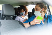 istock Passenger giving directions to a mobile application driver to reach their destination 1282421314
