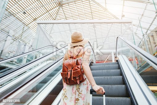 istock passenger in airport, woman traveling with backpack 621991356