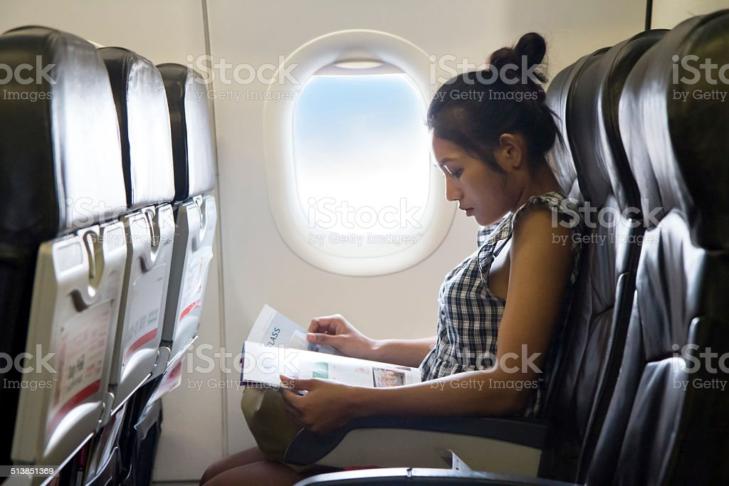 Passenger in the airplane royalty-free stock photo