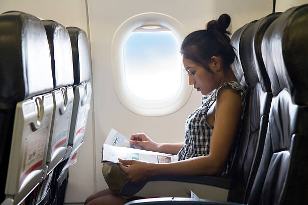 Passenger in the airplane stock photo