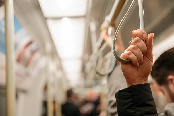passenger in the commuter train - hand grip stock photos and pictures