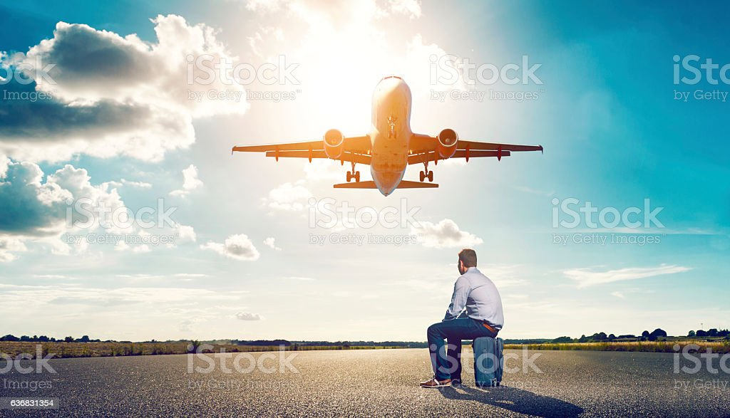 Passenger is left behind as airplane takes off stock photo