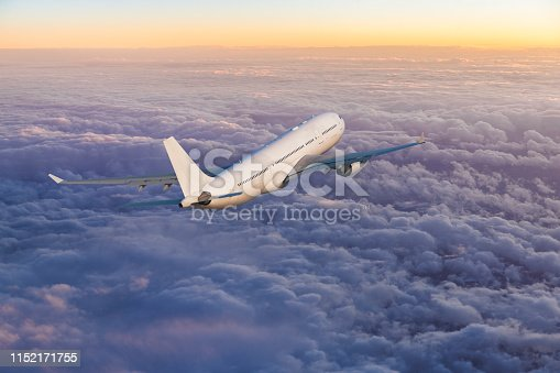 155439315istockphoto Passenger jet airplane flying above clouds at sunset 1152171755