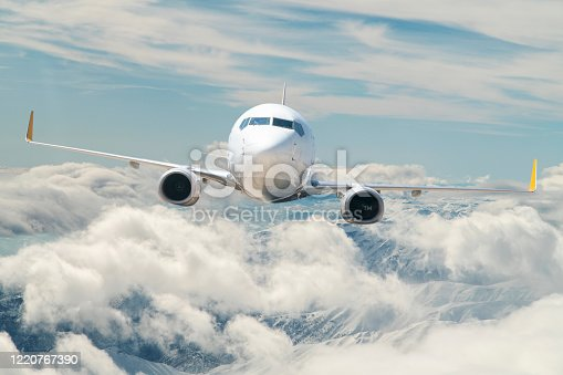 155439315 istock photo Passenger jet airplane flying above clouds 1220767390
