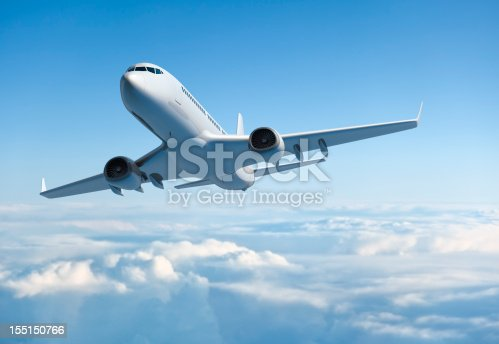 istock Passenger jet airplane flying above clouds 155150766