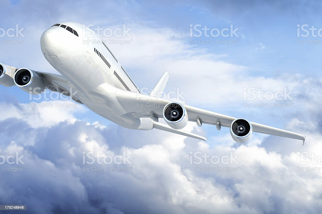 Passenger jet airplane in clouds royalty-free stock photo