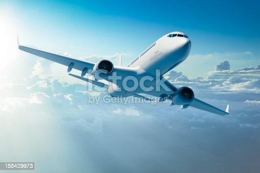 istock Passenger jet airplane over clouds 155429973