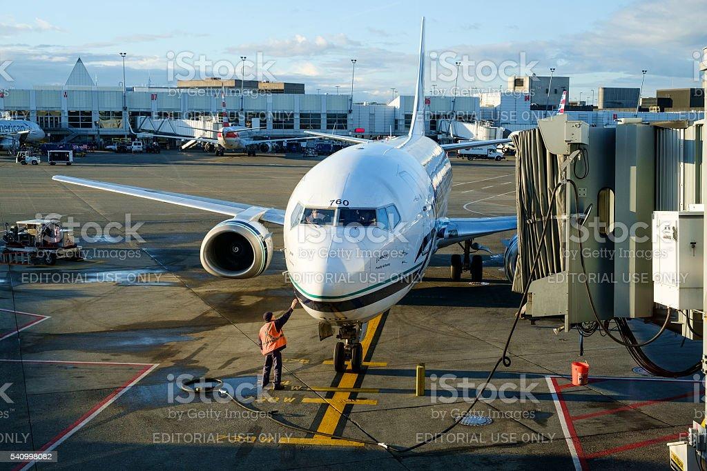 Passenger jet arriving at gate stock photo