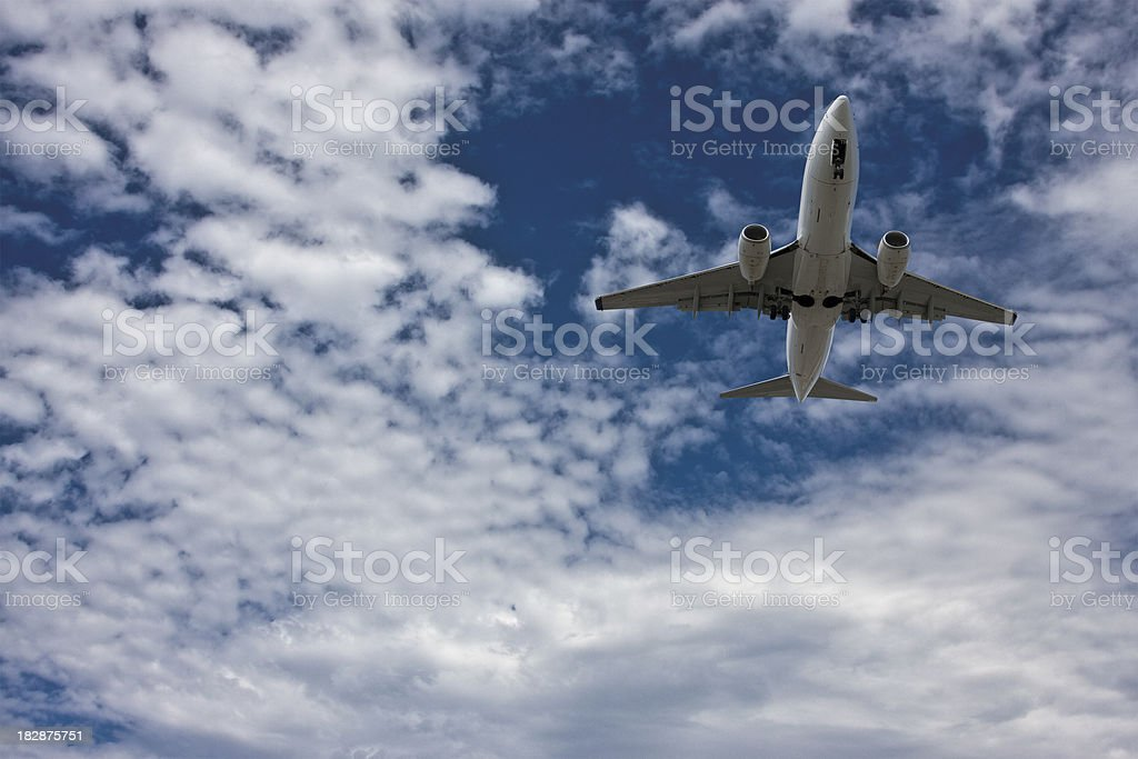 Passenger Jet Overhead stock photo