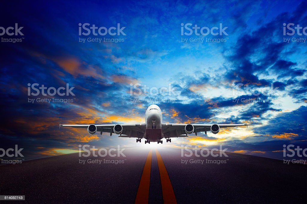 passenger jet plane take off from airport runway stock photo