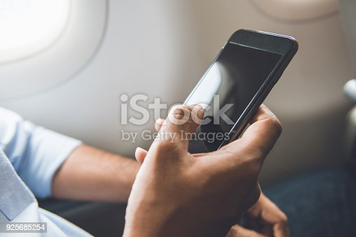 istock Passenger just turned off mobile phone on the airplane while traveling for safe flight 925685254