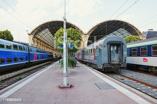 Nice, France - May 24, 2012: Passenger local and high speed TGV trains stand by the platforms.