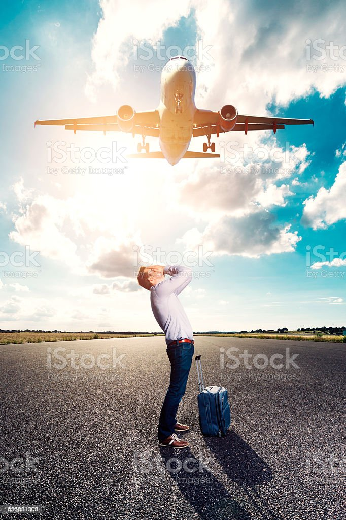 Passenger misses his plane and is unhappy and sad stock photo