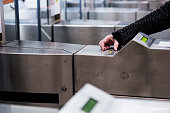 A passenger passes through an automatic ticket checking machine at a metro station. in Barcelona, CT, Spain
