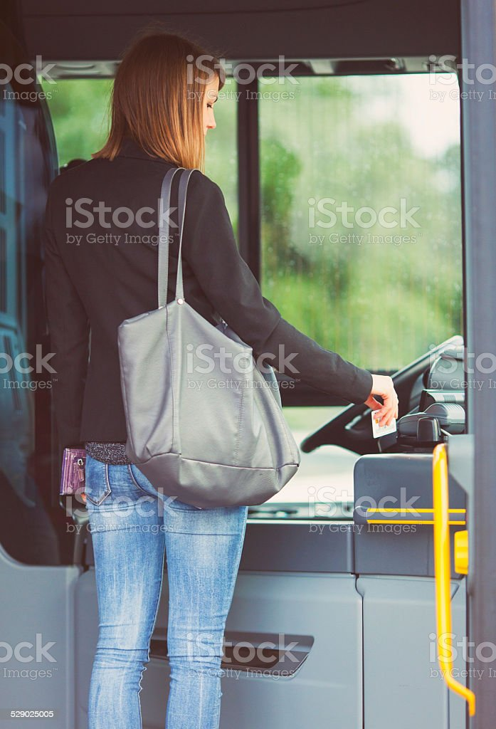 Passenger paying the bus fare with a contacless card stock photo