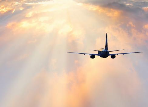 istock Passenger plane at sunset 477945211