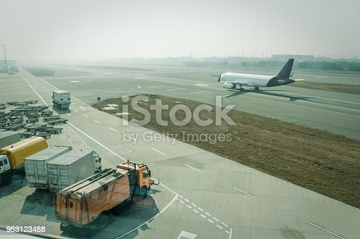 istock A passenger plane being serviced by ground services before next takeoff. 953123488