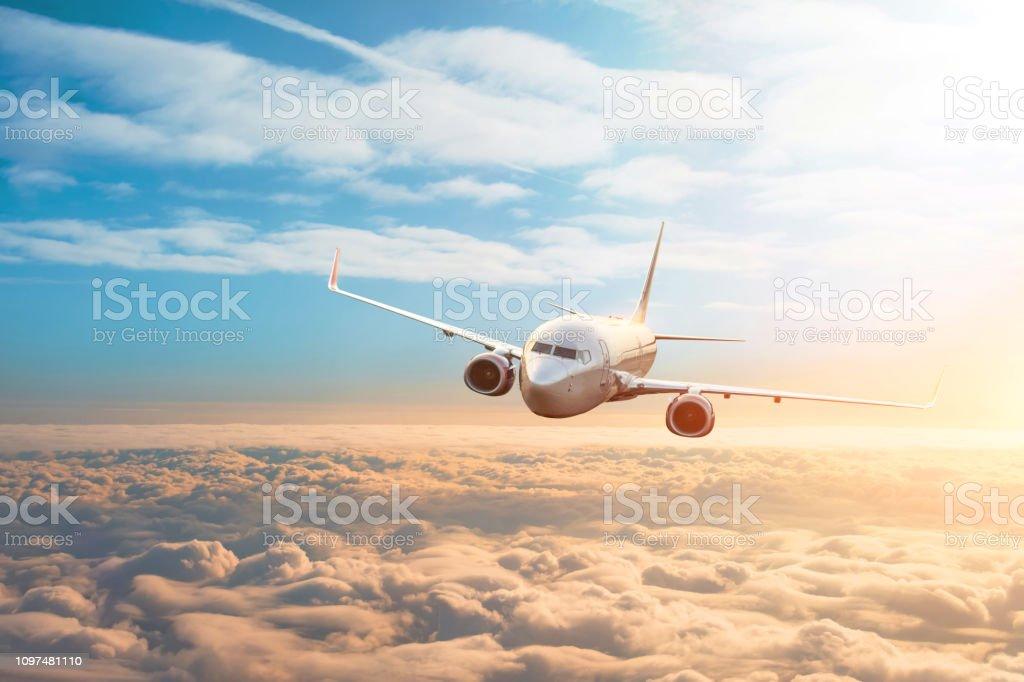 Passenger plane, business trip, travel concept. Flying evening sunset. Passenger plane, business trip, travel concept. Flying evening sunset Aerospace Industry Stock Photo