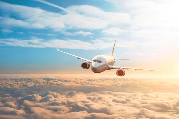 Passenger plane, business trip, travel concept. Flying evening sunset. Passenger plane, business trip, travel concept. Flying evening sunset mid air stock pictures, royalty-free photos & images