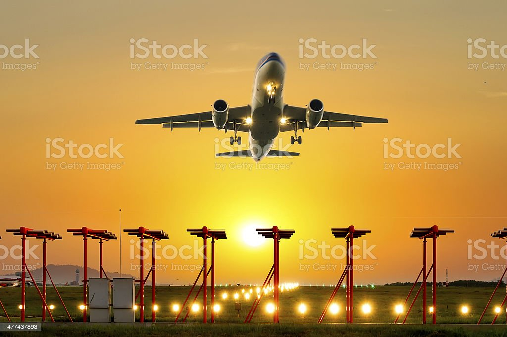 passenger plane fly up over take-off runway royalty-free stock photo