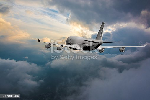 155439315istockphoto Passenger plane flying against sunset 647983036