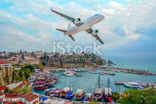 istock Passenger plane flying over the city. Old town (Kaleici) in Antalya, Turkey 967876802