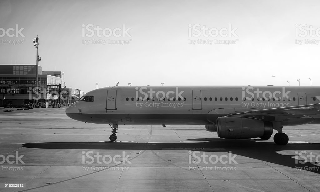 Passenger plane heading to the airport. Black and white. stock photo