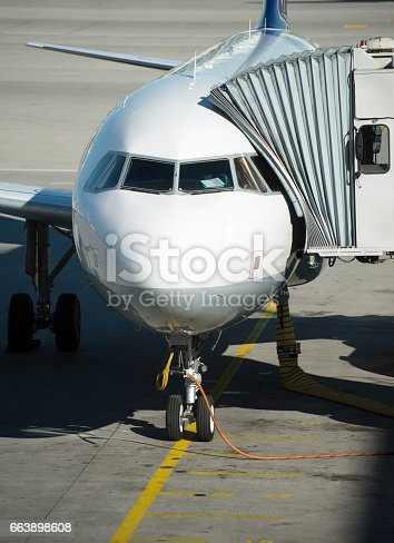istock Passenger plane in the airport. Boarding. 663898608