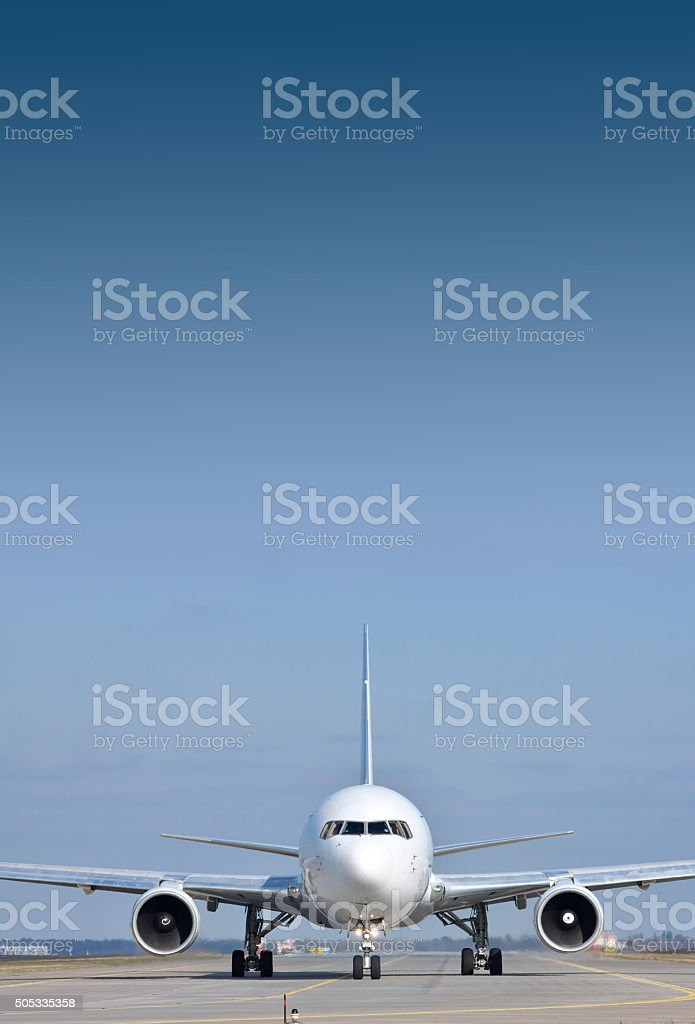 Passenger plane on runway stock photo