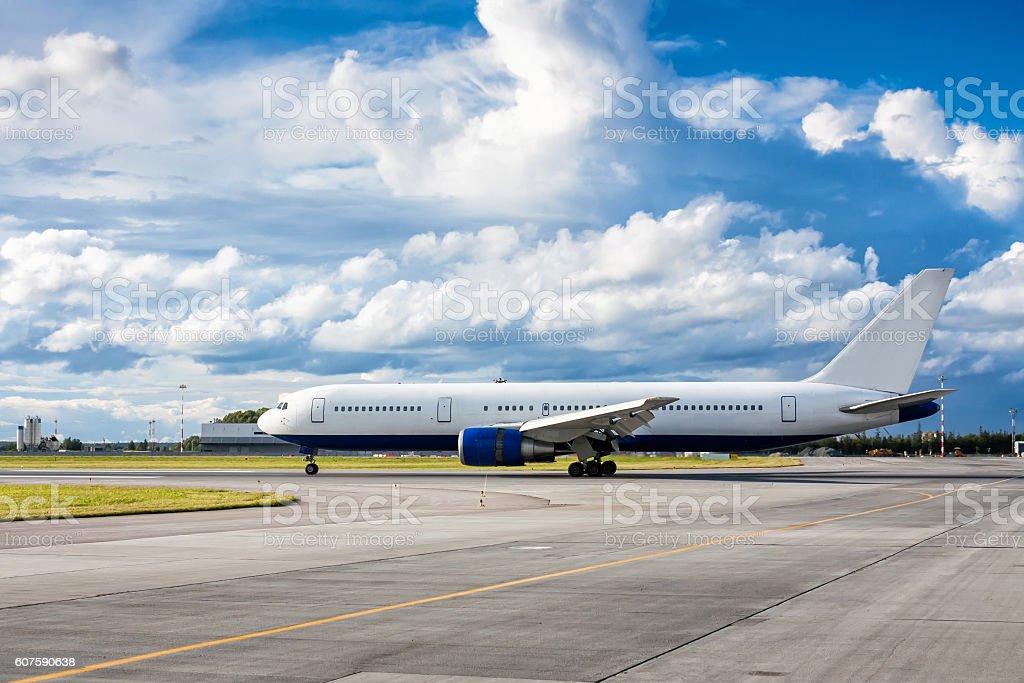 Passenger plane on the runway stock photo
