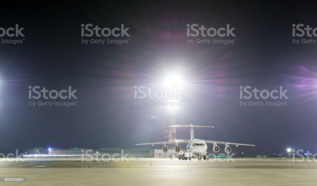 Passenger plane parked at the night airport. stock photo