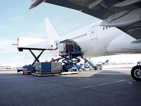 Passenger Plane being loaded.