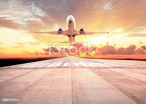 494996104istockphoto Passenger plane take off on sunset 539437814