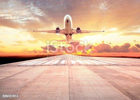 494996104 istock photo Passenger plane take off on sunset 539437814