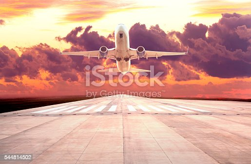 494996104istockphoto Passenger plane take off on sunset 544814502