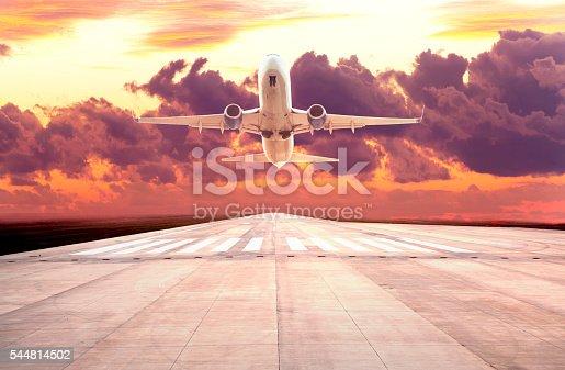 istock Passenger plane take off on sunset 544814502