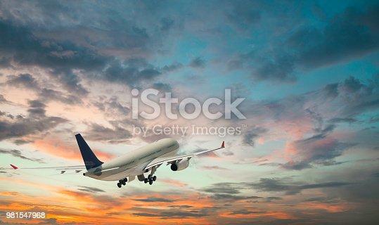 Passenger plane taking off at sunset