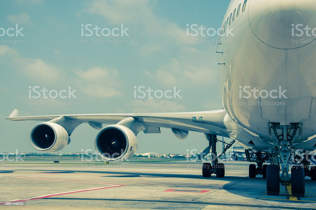 Passenger planes at the airport. Split tining stock photo