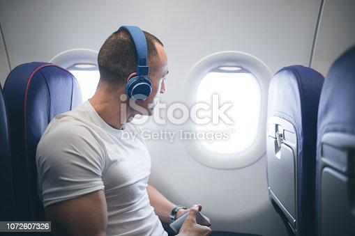 Young man in airplane