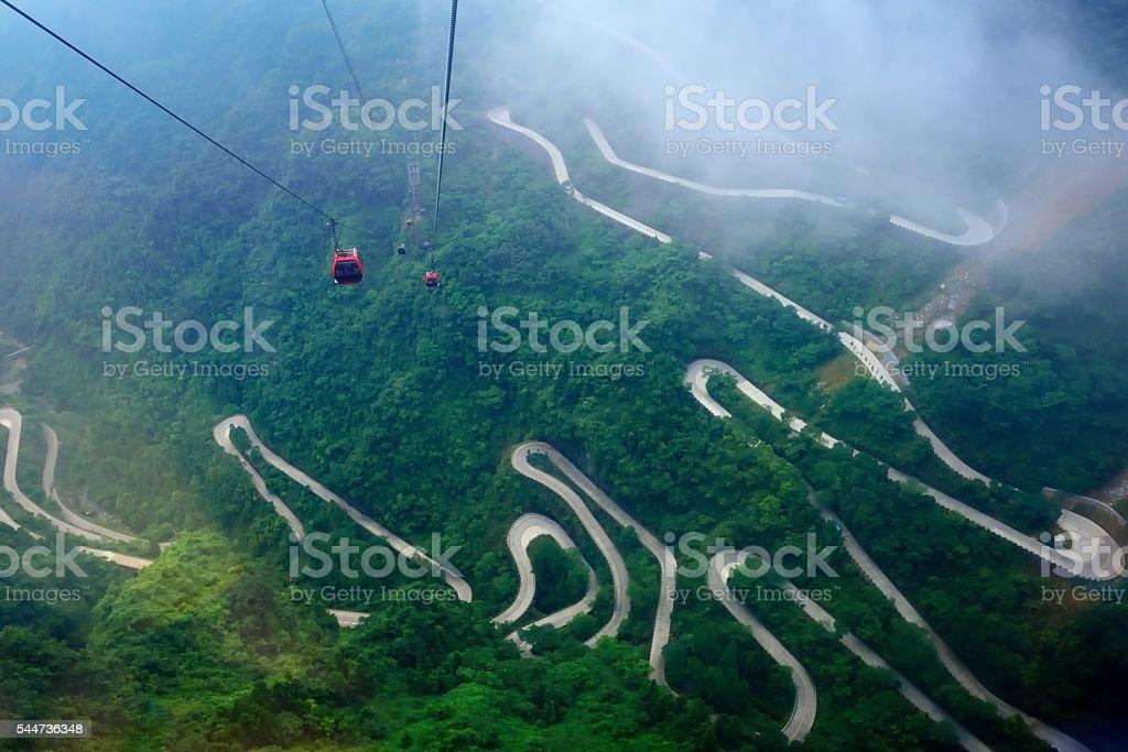 Passenger ropeway and winding mountain roads 01 stock photo