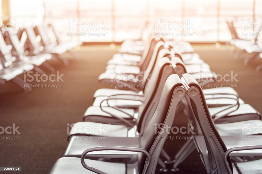 Passenger seat in Departure lounge for see Airplane, Waiting hall, view from airport terminal. Transport and travel concept. stock photo
