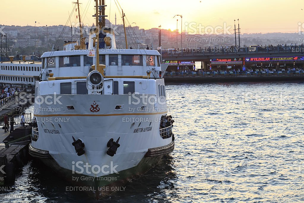 Passenger ships depart from the port in Eminönü stock photo