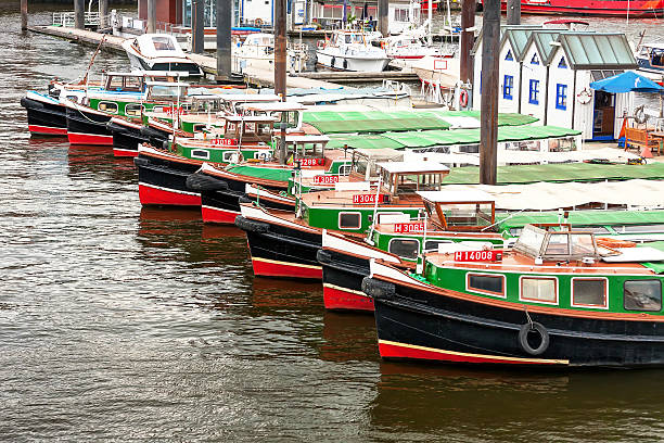 Passenger ships standing in row at the pier in Hamburg.