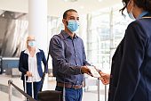 istock Passenger showing e-ticket at airport during covid pandemic 1307543592