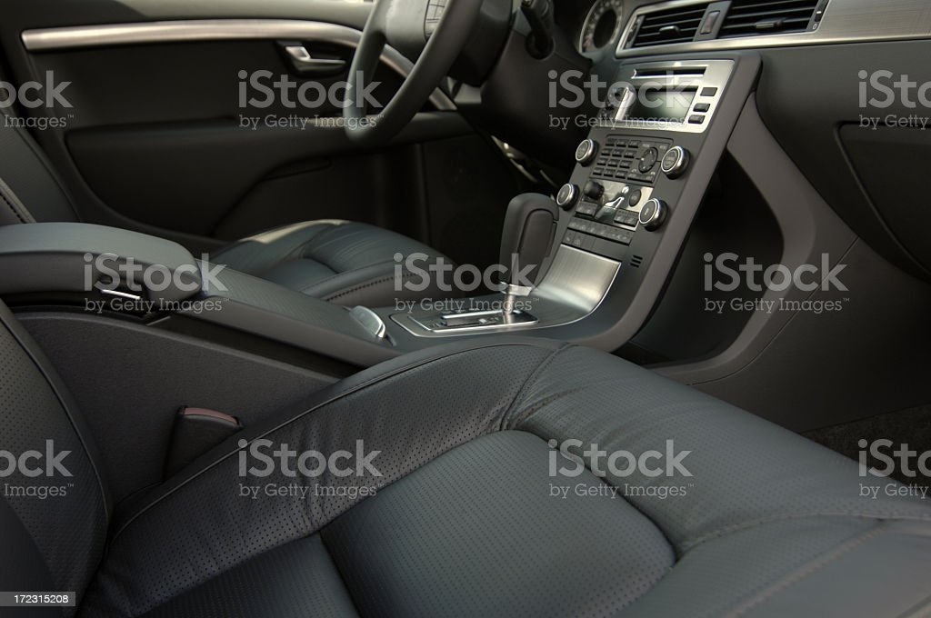 Passenger side view of the gray seats and panel in a car royalty-free stock photo