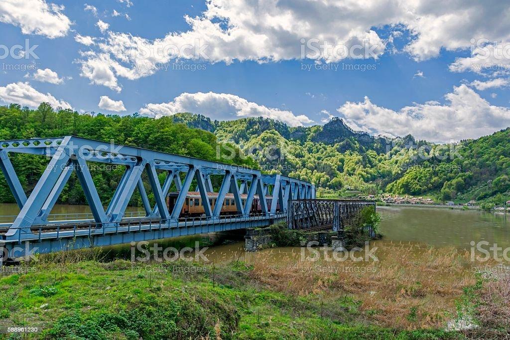 Passenger train crossing a bridge stock photo