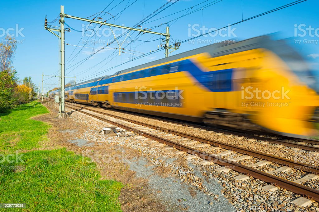 Passenger train moving at high speed stock photo