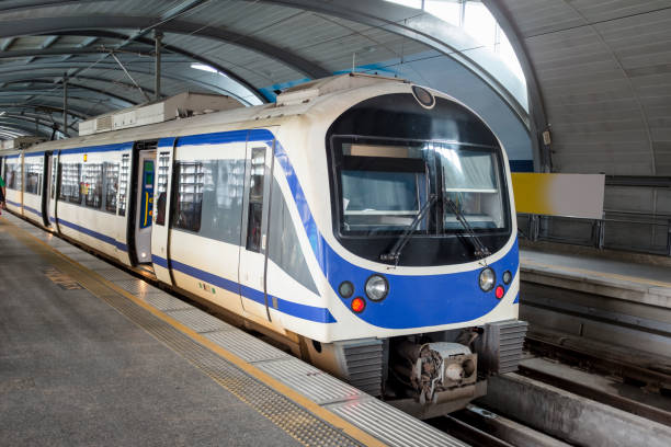 Passenger Train On Bangkok's Airport Link Elevated Electric Train On Bangkok's Airport Link electric train stock pictures, royalty-free photos & images