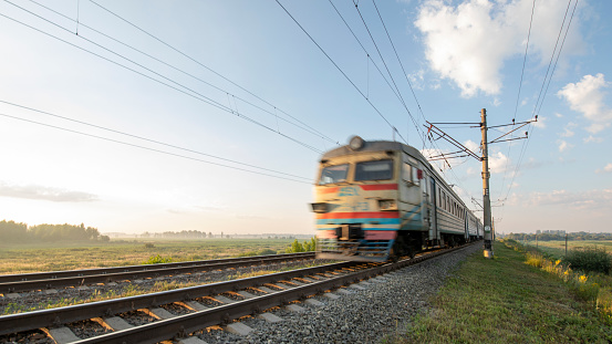 A passenger train on the railway is moving at high speed