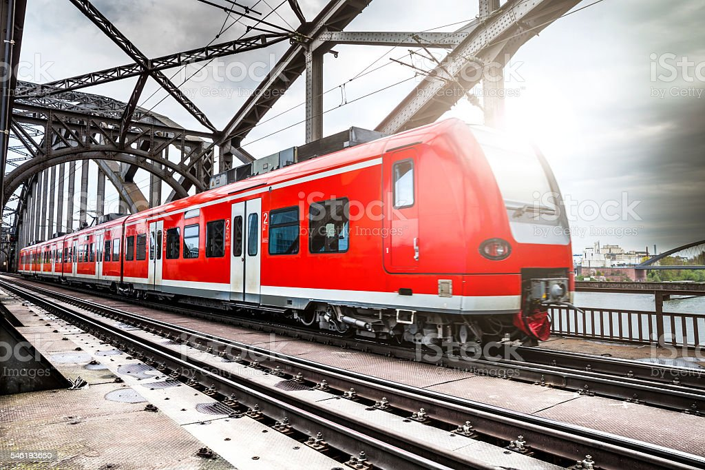 Passenger Train passing on a bridge in Frankfurt, Germany.